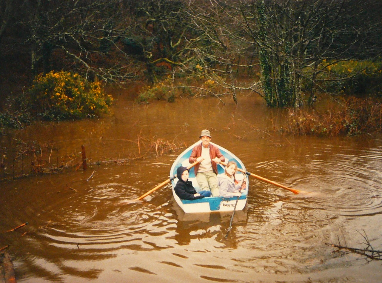 Prentice family boating on 'lake' after heavy rain, Zimapan,1987-89